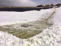 Heat strips melting ice around outflow irrigation pipe