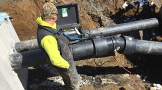Final pressure test, performed by onsite engineer, on newly installed pipe